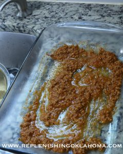 Place ½ c sauce in the bottom of lasagna pan.