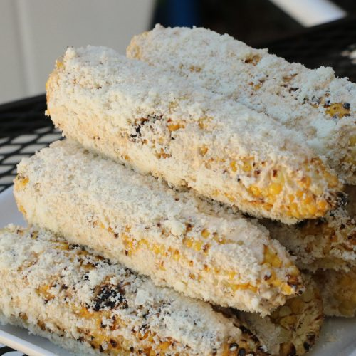 A picture of Mexican Corn with Grilled Corn, Cojita cheese, mayonaise and chipolte powder